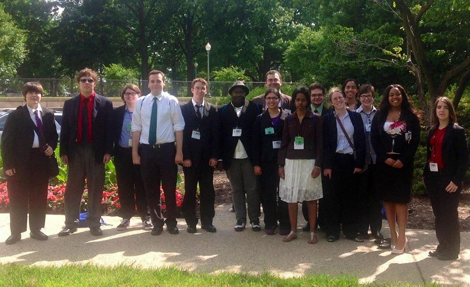 Photo of a group of ACI Summer Leadership academy attendees outside, dressed in business attire